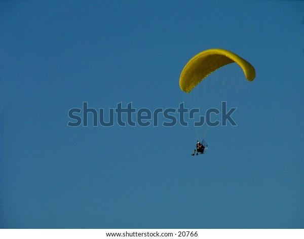 Paragliding on a deep blue sky