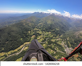 Paragliding over the Alps in a beautiful spring day, Italy