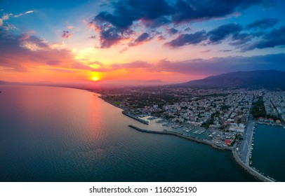 Paragliding over the the Beautiful coastal city of Kalamata and the port at sunset. Aerial cityscape view of Kalamata. It is the capital and the second largest city in the Peloponnese, Greece, Europe.
