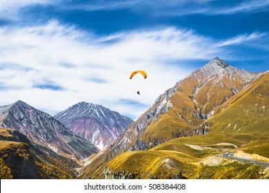 Paragliding over mountains of Gudauri.  Georgia. Europe.