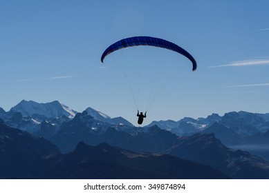 Paragliding over snow-clad mountains