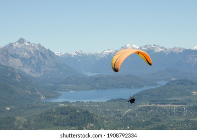 paragliding in pairs with instructor over bariloche, argentina, flying doing extreme sports