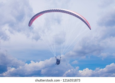 Paragliding. Paraglider flying in the sky