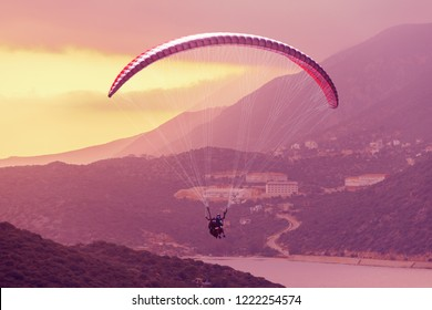 Paragliding. Paraglider flying in the sky over the sea