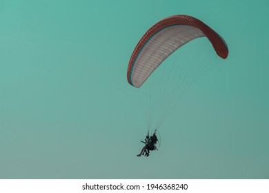 paragliding ,Paramotor flying on the sky adventure man active extreme sport pilot flying in sky with paramotor engine glider parachute. Man ride Paramotor flying in the sky