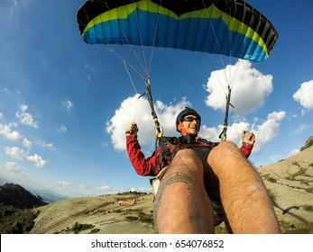 paragliding pilot smiling