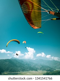 Paragliding in the Sky. Paraglide Tandem Flying in Pokhara Nepal over Himalaya Mountains. Extreme sport.