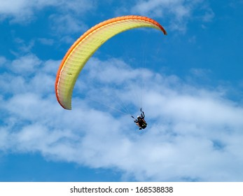 Paragliding in tandem against clear blue sky extreme sport background image