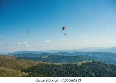paragliding in the Ukrainian mountains, nice blue mountain and sky,