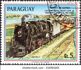 """PARAGUAY - CIRCA 1986: A stamp printed in Paraguay from the """"Locomotives """" issue shows Locomotive 3038, Nopala, Mexico, circa 1986."""