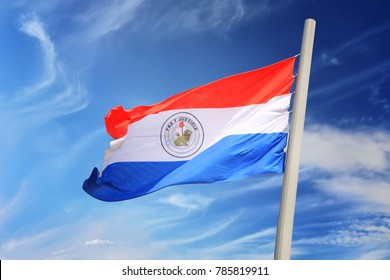Paraguayan flag against the background of the blue sky