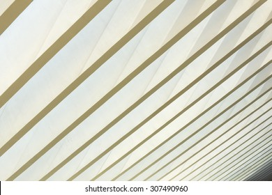 Parallel beams of unique geometrical architectural style ceiling allows natural light to penetrate