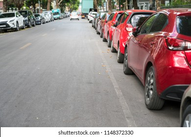 Parallel parking cars on urban street. Outdoor parking on road