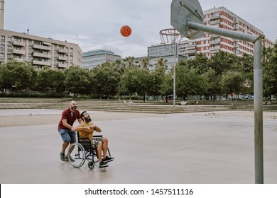 a paralytic man plays basketball on his wheelchair