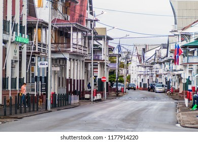 PARAMARIBO, SURINAME - AUGUST 5, 2015: Street with old colonial buildings in Paramaribo, capital of Suriname.