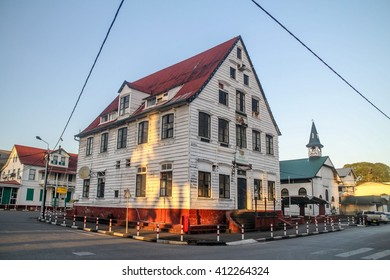 PARAMARIBO, SURINAME - AUGUST 6, 2015: Street with old colonial buildings in Paramaribo, capital of Suriname.