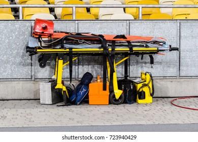 Paramedic ambulance equipment at football stadium for help.