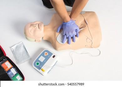 Paramedic demonstrate Cardiopulmonary resuscitation (CPR) on  dumm