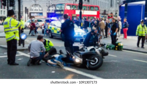 The paramedics and firemen provide first aid to victims in a motorcycle accident on Piccadilly Street. London. UK. Blurred view