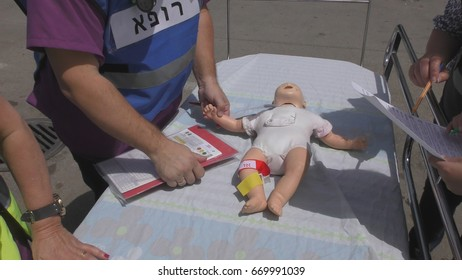 Paramedics and medical staff give first aid to baby mannequin victims of earthquake terror biohazard attack fire tsunami war in Haemek Hospital during drill. Afula, Israel, April 27th, 2017