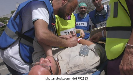 Paramedics and medical staff give first aid to victims of earthquake terror biohazard attack fire tsunami war in Haemek Hospital during drill. Afula, Israel, April 27th, 2017