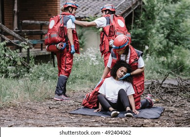 Paramedics rescuing disaster victim