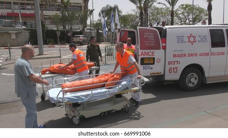 Paramedics unload from ambulance injured mannequins victims of earthquake terror biohazard attack fire tsunami war in Haemek Hospital during drill. Afula, Israel, April 27th, 2017