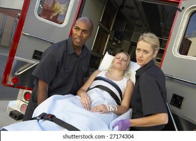 Paramedics unloading patient from ambulance