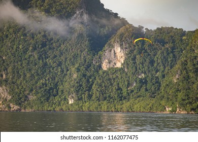Paramotor flying at morning time, It is a beautiful view around Panyee island, Phuket, Thailand