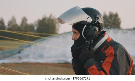 Paramotorgliding. Portrait of a man removing safety helmet after landing. High quality photo