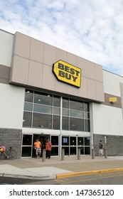 PARAMUS - JULY 9: Shoppers walk past a Best Buy consumer electronics store in Paramus, New Jersey, on Tuesday, July 9, 2013.