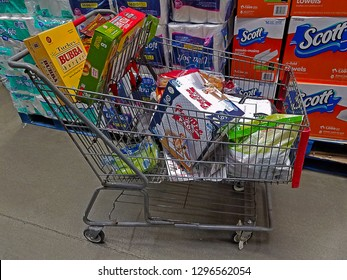 PARAMUS, NEW JERSEY/USA - NOVEMBER 29, 2017: A shopping cart filled with various groceries and pet supplies at a local BJ's Membership Warehouse. This cart was left in the aisle unattended.