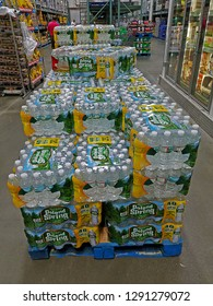 PARAMUS, NEW JERSEY/USA - OCTOBER 3, 2017: An number of pallets full of cases of Poland Spring natural spring water at BJ's Wholesale Club. Each case of water contains forty 16.9 ounce bottles.