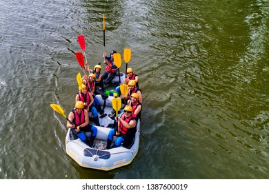 Paranesti, Drama, Greece - May 1, 2019: Aerial view of adventure team doing rafting on the cold waters of the Nestos River in Paranesti. Nestos river is one of the most popular among rafters in Greece