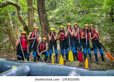Paranesti, Drama, Greece - May 1, 2019:  adventure team that prepares to do rafting on the cold waters of the Nestos River in Paranesti. Nestos river is one of the most popular among rafters in Greece