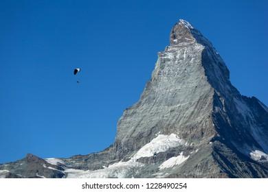 Parapenter flying near the famous Matterhorn in Zermatt, Switzerland.