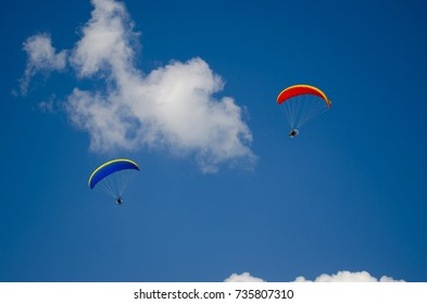 The paraplanes flies in the clouds on the celebration of World Civil Aviation Day.