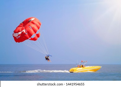 Parasailing - active form of recreation, in which a person is fixed with a long rope to a moving boat and thanks to presence of special parachute hovers through the air