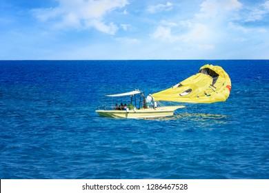 Parasailing in Aegean Sea in city of Rhodes (Rhodes, Greece)