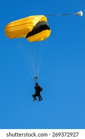 parasailing in the clear sky