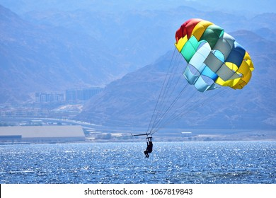 Parasailing entertainment at the beach of Eilat - israeli resort city at the red sea.