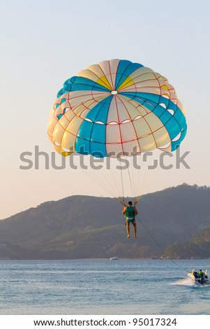Parasailing in the eveing, taken in Phuket Patong Beach, Thailand