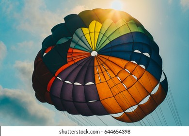 parasailing floating in the sky