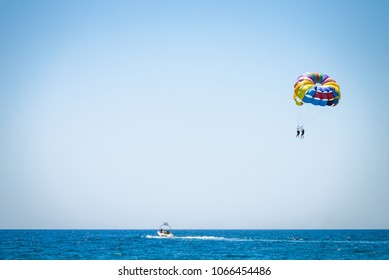 Parasailing on sea. Parasailing is a popular pastime in many resorts around the world.