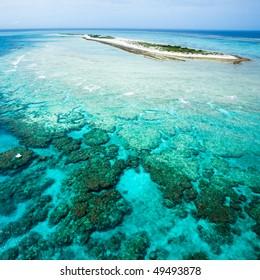 Parasailing over deserted tropical island, Okinawa, Japan