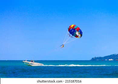 Parasailing is a popular pastime in many resorts around the world. The active form of relaxation. Focus on a parachute.
