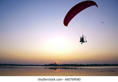 Parasailing  silhouette, Silhouette,Parasailing over the river in Thailand.