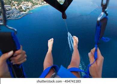 Parasailing in summer on the Adriatic Sea