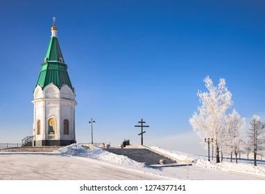 Paraskeva Pyatnitsa Chapel on Karaulnaya mountain in a frosty sunny day. Russian Orthodox Church on the background of blue sky in winter, Krasnoyarsk, Russia.