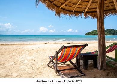Parasol and deck chair at Ao Kao beach in Koh Mak island, Trat, Thailand